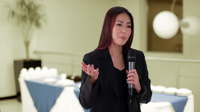 japanese businesswoman talking in a meeting - auditorium stock videos and b-roll footage