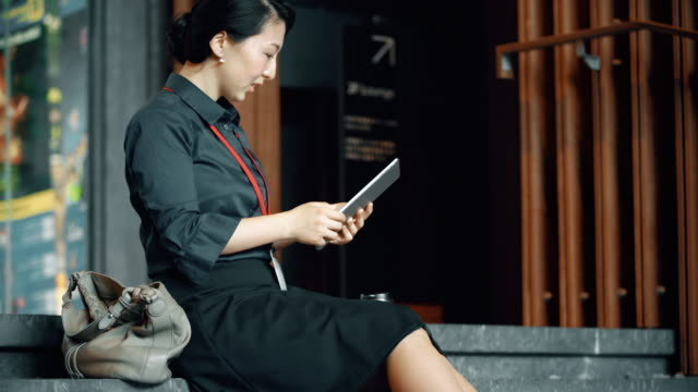 DS Japanese businesswoman using a digital tablet