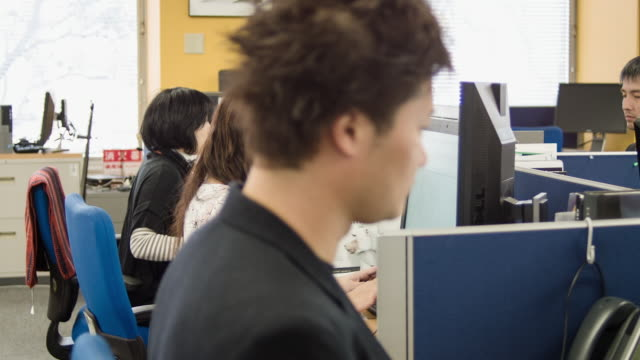 Japanese bussines person working in office.