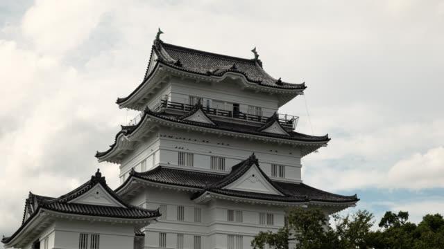 japanese castle (time lapse/tilt down) - samurai stock videos & royalty-free footage