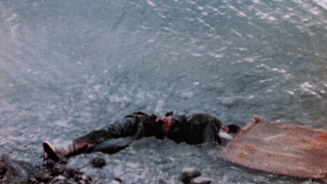 ha japanese casualty lying where he fell half in water and half on rocky shore / saipan mariana islands - mariana islands stock videos and b-roll footage