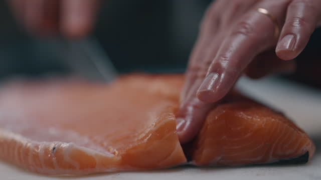 japanese chef cutting and preparing raw salmon for sushi making - cutting stock videos & royalty-free footage