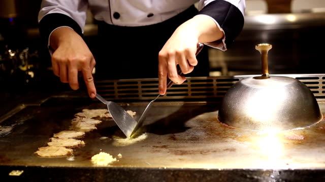 Japanese chef make pork teppan on Japanese Restaurant