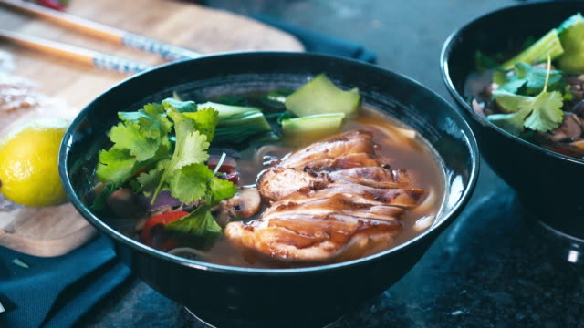 japanese chicken ramen noodle soup - chopped stock videos and b-roll footage