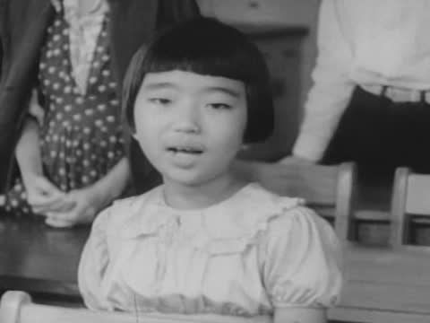 japanese children, lined up in front of schoolhouse, chanting american patriotic slogans/ japanese schoolchildren singing 'god bless america' - schoolhouse stock videos & royalty-free footage