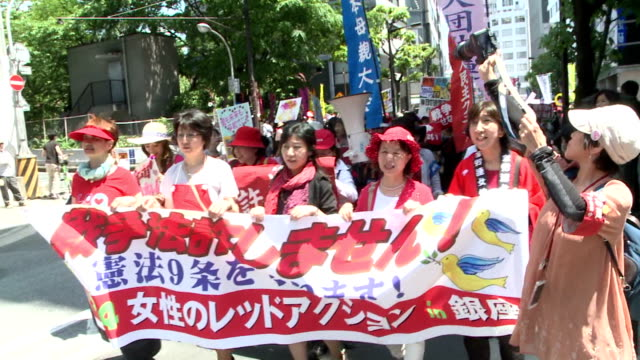 japanese civic groups held protests thursday against security bills the cabinet of prime minister shinzo abe is set to approve later in the day... - japan self defense forces stock videos and b-roll footage