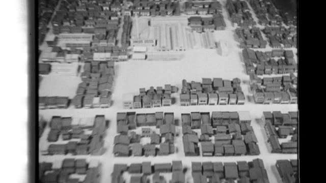 japanese civil defense planners use models and animations to devise a strategy to cope with american air raids and implement as they remove wooden... - anti aircraft stock videos & royalty-free footage