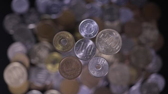 japanese coins of one yen five yen ten yen fifty yen one hundred yen and five hundred yen are arranged for video in tokyo japan on tuesday june 20... - 硬貨点の映像素材/bロール