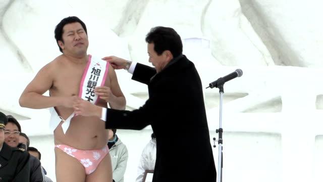 japanese comedian tonikaku akarui yasumura, known for his posing which look like 'almost naked' but actually wearing underwear, named asahikawa... - asahikawa stock videos & royalty-free footage