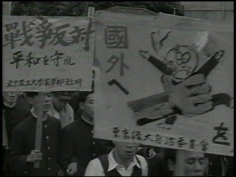 japanese communist newspaper akahata vs communist party members marching w/ signs large group demonstrating protesting on streets people chanting... - communist party stock videos and b-roll footage