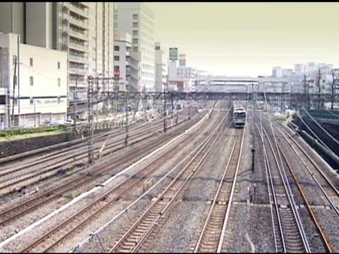 Japanese Commuter Trains Pass near Yokohama Station.