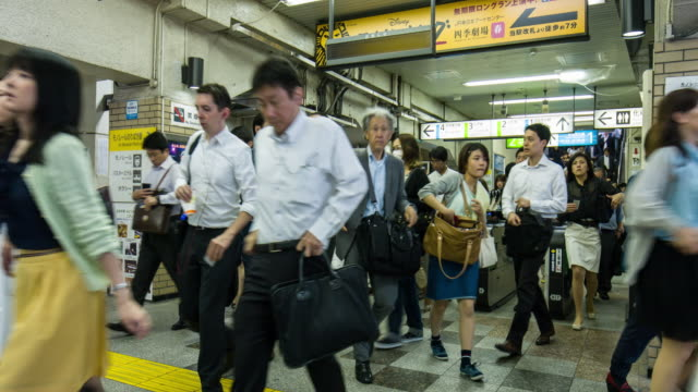 japanese commuters going to work in tokyo - western script stock videos & royalty-free footage