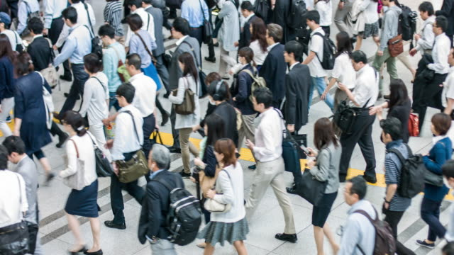 japanese commuting to work in tokyo - commuter stock videos & royalty-free footage