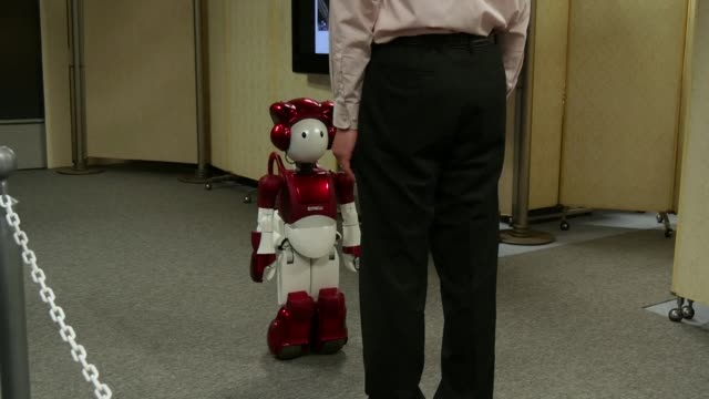 japanese company hitachi unveils its humanoid robot which is able to have a short conversation with a human being without being given a script - japanese script stock videos & royalty-free footage