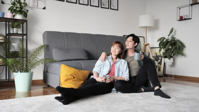 japanese couple moving to new apartment and enjoying the moments together - tenant stock videos & royalty-free footage