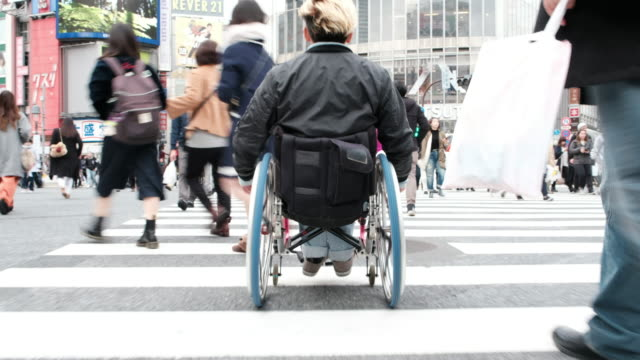 japanese crosswalk in a wheelchair - persons with disabilities stock videos & royalty-free footage