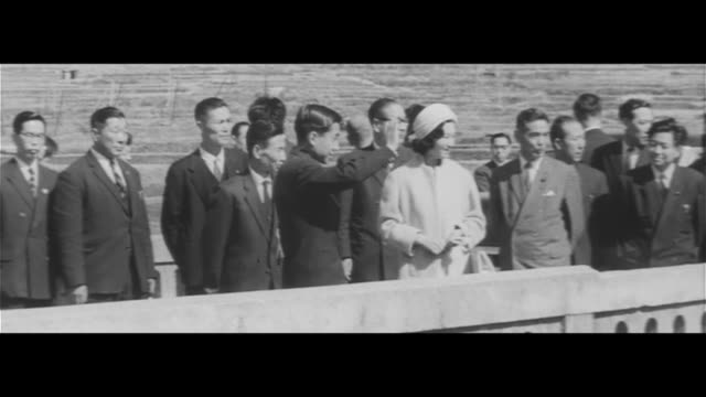 japanese crown prince akihito and crown princess michiko in shinano observing touring totoku electric factory looking at a fine electric wire through... - crown prince stock videos & royalty-free footage