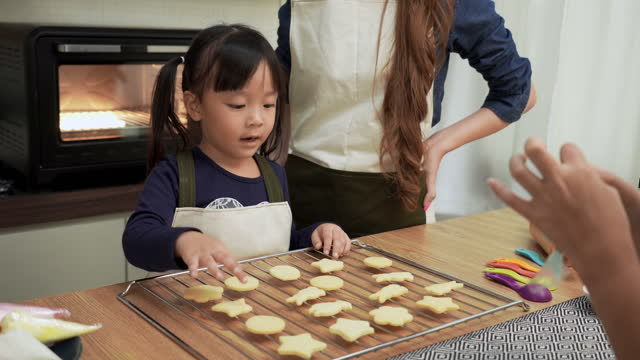 japanese daughter counting number of cookie on a tray after preparing with asian mother, brother. concept of asian family with two children cooking, baking bakery.  children having positive emotions. - domestic kitchen stock videos & royalty-free footage