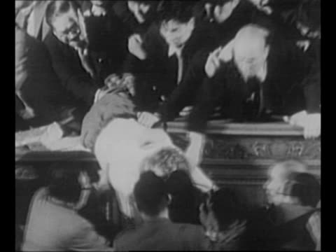 japanese diet members pull gray-haired socialist speaker off of the speaker's desk, after several attempts, during a riot in the assembly / clock... - 天皇点の映像素材/bロール