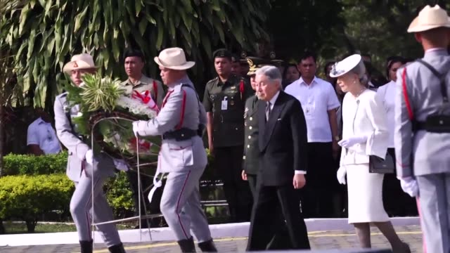 japanese emperor akihito bows his head in sorrow during a sombre ceremony at the philippines' biggest war cemetery - emperor akihito stock videos and b-roll footage