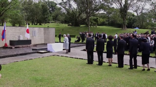 japanese emperor akihito offers flowers at a shrine built in the philippines for japanese soldiers killed during japans brutal world war ii... - emperor akihito stock videos and b-roll footage