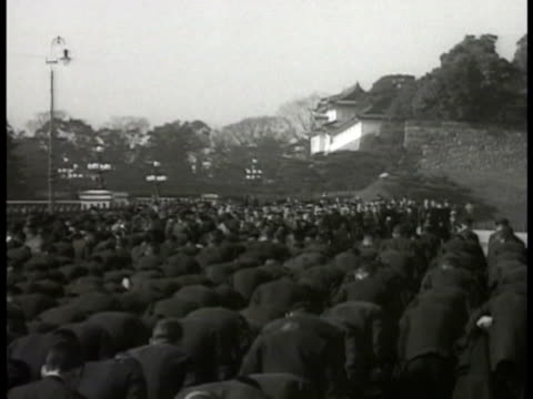 japanese emperor hirohito on white horseback alone walking w/ others vs large crowd of japanese people outside bowing - hirohito stock videos & royalty-free footage