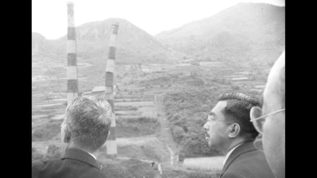 japanese emperor hirohito surveys damage in nagasaki during a visit several years after an atomic bomb was dropped on the city. - 1949 stock videos & royalty-free footage