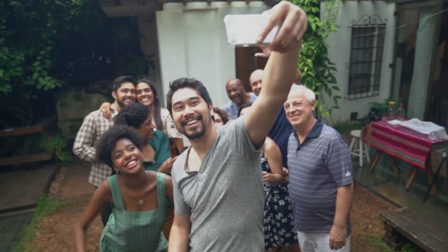 japanese ethnicity man taking a selfie of friends/family at barbecue party - life events stock videos & royalty-free footage