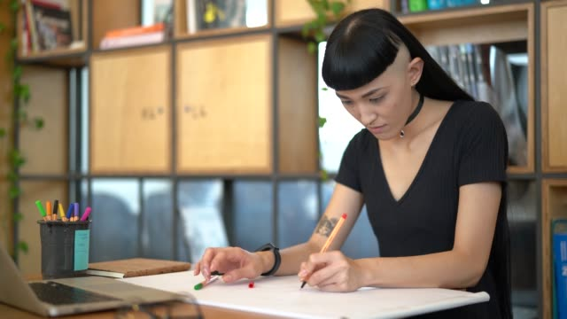 japanese ethnicity woman drawing a new project at work studio - fashion designer stock videos and b-roll footage