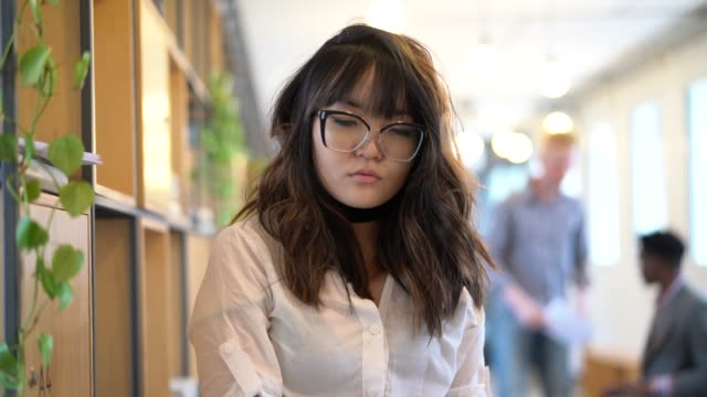 japanese ethnicity woman portrait at startup modern office - pardo brazilian stock videos & royalty-free footage