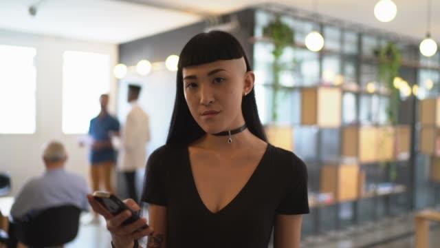 japanese ethnicity woman portrait using mobile at work studio - pardo brazilian stock videos & royalty-free footage