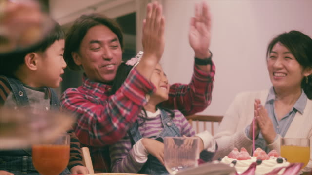 japanese family celebrates a birthday - dessert stock videos & royalty-free footage