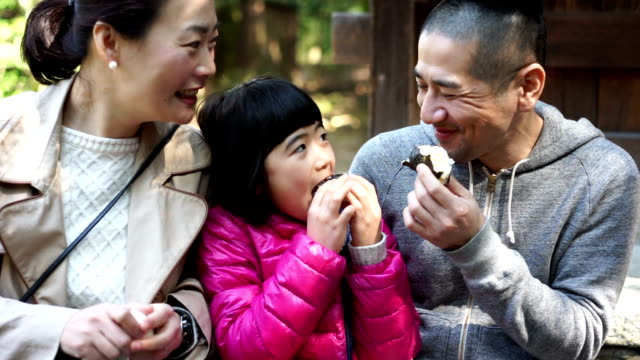 Japanese family eating onigiri together