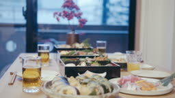 Japanese family eating osechi Ryori on New Year's Eve