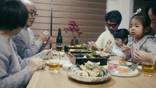 japanese family eating osechi ryori on new year's eve - multi generation family stock videos & royalty-free footage