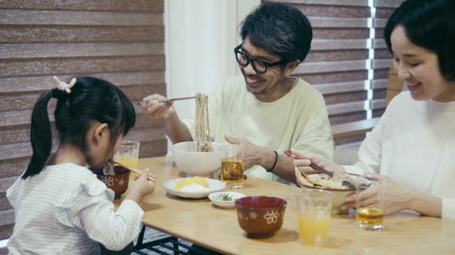 japanese family eating toshikoshi soba (new year's eve noodles) noodles - dining table stock videos & royalty-free footage