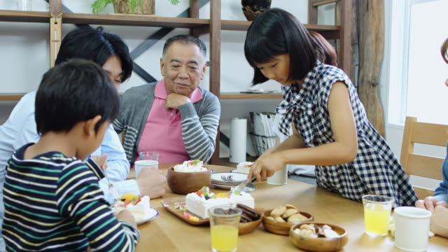 japanese family having cake at home - dining table stock videos & royalty-free footage