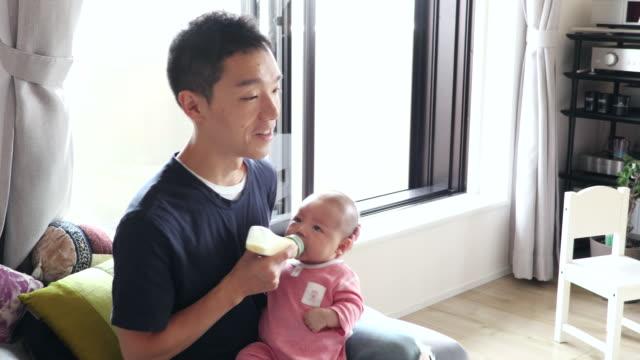 japanese family - biberon video stock e b–roll