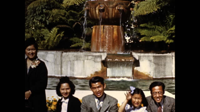 japanese family walking to the camera, smiling; family sitting by the fountain; standing behind orange flowers smiling at the camera, little girl... - 1930 1939 stock videos & royalty-free footage