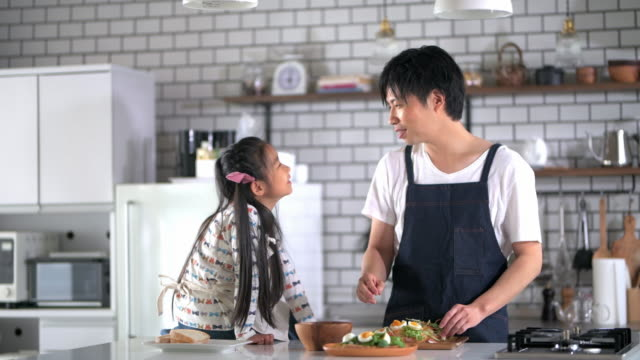 japanese father and daughter talking in kitchen - preparing food stock videos & royalty-free footage