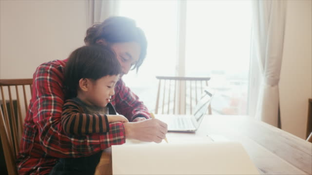 japanese father and son spending time together while drawing - genderblend stock videos & royalty-free footage