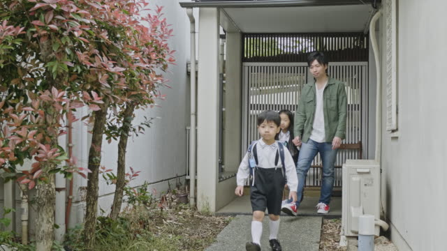 japanese father leaving home to school with children - japanese school uniform stock videos & royalty-free footage