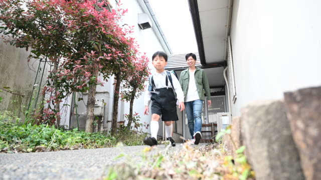 japanese father walking children to school - japanese school uniform stock videos & royalty-free footage