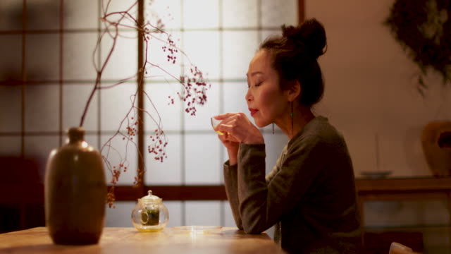 Japanese Female drinking green tea in traditional house, Japan, Kyoto