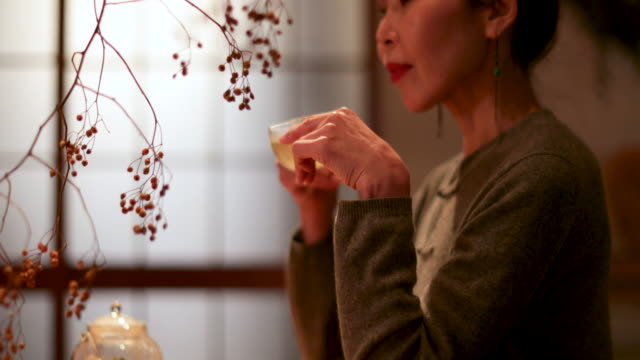 japanese female drinking green tea in traditional house, japan, kyoto - traditional ceremony stock videos & royalty-free footage