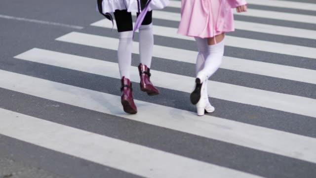japanese female friends running across crossing, harajuku, tokyo, japan - rebellion stock videos & royalty-free footage