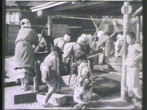 stockvideo's en b-roll-footage met japanese female pumping handoperated water pump ws female pumping other farm workers washing materials vs females by stream washing vegetation rural... - 1942
