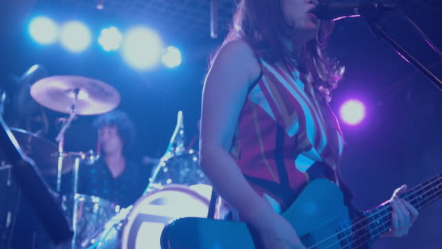japanese female singing and playing bass on stage. - live event stock videos & royalty-free footage