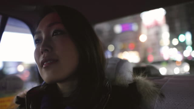 Japanese female sitting in Taxi, Tokyo, Japan