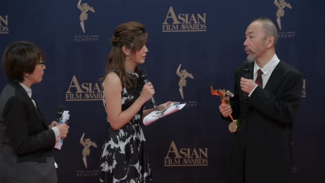 japanese film director shinya tsukamoto and musician haruomi hosono at the winner's press conference of the 13th asian film awards on march 17,2019... - film director stock videos & royalty-free footage